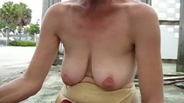Mature lady Lisa flashing her saggy boobs in public.