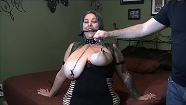 Chastity wears a bridle collar and nip clamps having her tits tortured