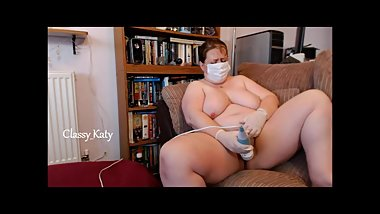 Mature English nurse in mask & gloves