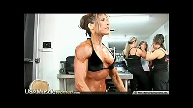 incredible muscular older woman pumping up for show