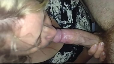 Blonde mature slut chews on a big cock