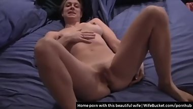This beautiful amateur wife enjoys being fucked while making home porn tape