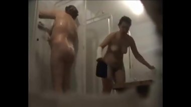 Spying chubby Moms in public shower room