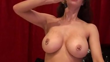 Amica Bentley playing with big pierced fake boobs