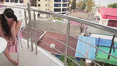 Feet care Naked on the balcony – Naughty Lada