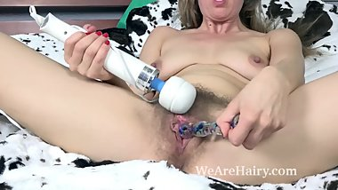 Valentine masturbates in bed with her toys