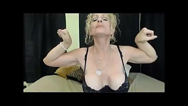 GILF flexes her biceps
