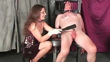 Cock and balls whipping with a leather slapper