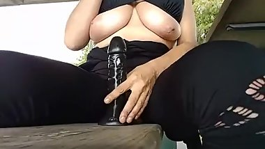 Mature playing with herself at the park