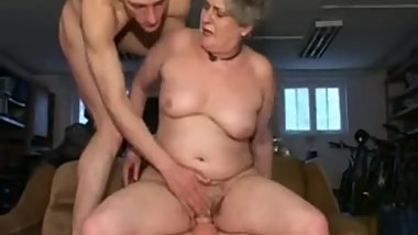 Sandora granny has sex with two guys on a couch.