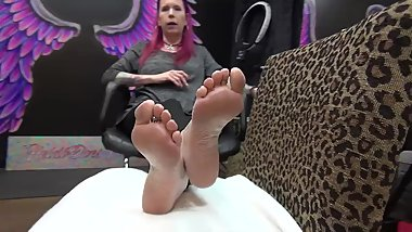 Redheaded lady's feet with tattoos