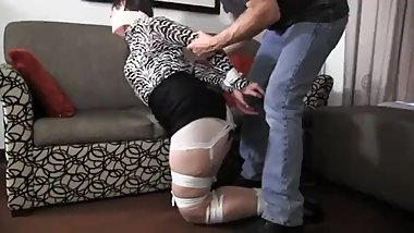 Mature woman, bound, microfilm gagged with breasts exposed