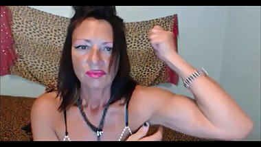 Willing old lady flexes her biceps on cam