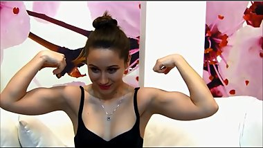 Cute muscle girl shows hairplay biceps